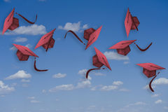 Graduation hats in the air. Royalty Free Stock Images