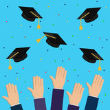 Graduation hats, hands, air 1 Stock Photo