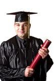Graduation heureuse un jeune homme Photos stock