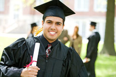 Graduation: Hispanic Student Happy to Graduate. Extensive series of recent student graduates after graduation, outside with friends. Muti-ethnic group includes Royalty Free Stock Image