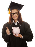 Graduation holding pink piggy bank Stock Images