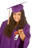 Graduation of indian girl. Young female in graduation gown holding her diploma - graduating Royalty Free Stock Images
