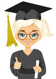 Graduation little girl holding her diploma with pride Stock Photo