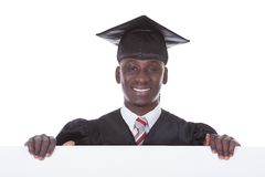 Graduation Man With Bill Board Royalty Free Stock Photography
