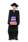 Graduation man holding books Stock Image