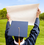 Graduation man holding paper Royalty Free Stock Photo