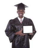 Graduation Man Holding Tablet Pc Royalty Free Stock Images