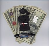Graduation money. Graduation accessories on money Stock Image