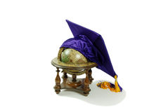 Graduation mortar board and globe. Graduation mortar board with tassle used during ceremonies, Old world globe with basic navigation notations Royalty Free Stock Photography
