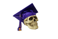 Graduation mortar board and skull. Graduation mortar board with tassle used during ceremonies and Skull with eye sockets and teeth Stock Photos