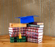 Graduation mortarboard on top of stack of books Stock Photos