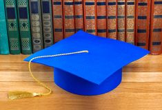 Graduation mortarboard on top of stack of books Stock Photography