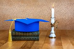 Graduation mortarboard on top of stack of books Stock Photo