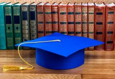 Graduation mortarboard on top of stack of books Royalty Free Stock Photo