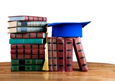 Graduation mortarboard on top of stack of books Stock Images