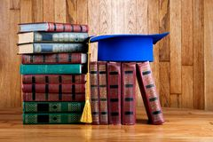 Graduation mortarboard on top of stack of books Royalty Free Stock Image