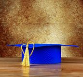 Graduation mortarboard on wooden table Stock Images