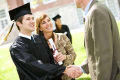 Graduation: Mother Stands By Son with Pride Royalty Free Stock Photography