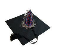 Graduation Party. A black graduation cap with a party hat,over white Stock Image