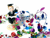 Graduation Party. Graduate figurine and colorful party garland Stock Images
