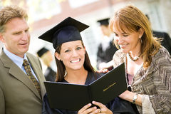 Graduation: Proud Family with Graduate Daughter. Extensive series of recent student graduates after graduation, outside with friends. Muti-ethnic group includes stock photography
