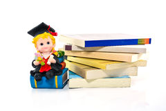Graduation resin doll and books Royalty Free Stock Image