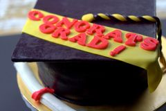 Graduation shaped fondant cake Royalty Free Stock Photography