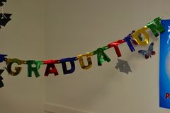 Graduation sign hanging on the wall stock image