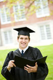 Graduation: Smart Student Holds Diploma Stock Images