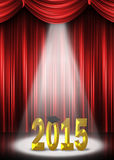 Graduation 2015 in the spotlight. Gold 2015 graduation in the spotlight with red curtain background Royalty Free Stock Photo