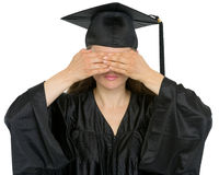 Graduation student girl making see no evil gesture Royalty Free Stock Photos