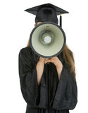 Graduation student speaking megaphone into camera Stock Photo