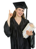 Graduation student with stack of books got idea Royalty Free Stock Image