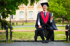 Graduation: Student Standing With Diploma Stock Images