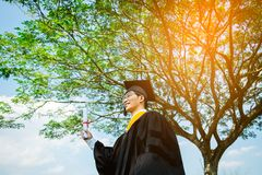Graduation: Student standing up and smile holding Graduation cer Stock Image