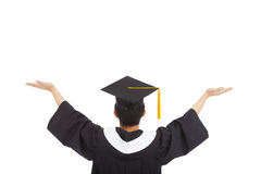 Graduation student wearing a mortarboard and open hands. Over white Royalty Free Stock Image