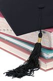 Graduation Tassel on Old Books Stock Images
