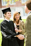 Graduation: Teacher Congratulates New Graduate stock image