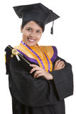 Graduation time. A woman student in graduation suit while holding her certificate container Stock Image