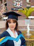 Graduation woman. Beautiful graduation girl in City of London Royalty Free Stock Images