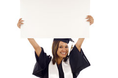 Graduation woman with a banner Stock Photos