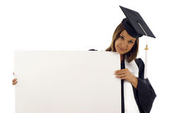 Graduation woman with a banner Royalty Free Stock Images