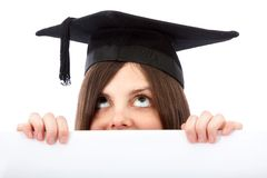 Graduation woman holding ad Royalty Free Stock Images