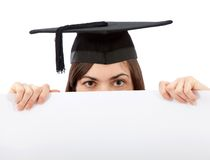 Graduation woman holding ad Royalty Free Stock Photos