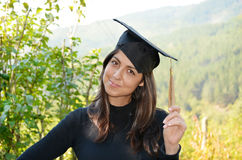 Graduation woman portrait with university black hat Royalty Free Stock Images