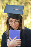 Graduation woman portrait with university black hat Royalty Free Stock Photos