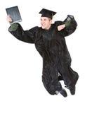 Graduazione: Uomo con il diploma eccitato per laurearsi i salti in aria Fotografia Stock Libera da Diritti