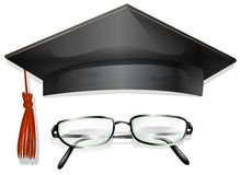 Graducation cap and eyeglasses Royalty Free Stock Photo