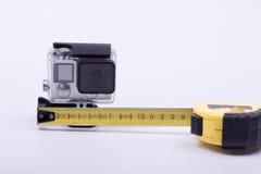 Gradui la camma secondo la misura di azione della macchina fotografica su un fondo bianco Fotografia Stock