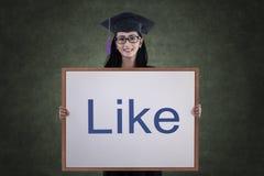 Graduierte Holding der asiatischen Frau mögen Brett in der Klasse Stockbilder